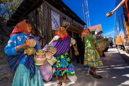 Tarahumara Indian women selling handwoven baskets at the CHEPE (Chihuahua al Pacifico) train, stopped at San Rafael, Copper Canyon, Mexico